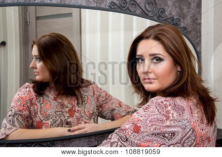 Beautiful Middle-aged Woman Sitting Near Mirror.