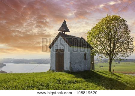 Little Chapel On The Hill, View To Lake Riegsee, Bavaria