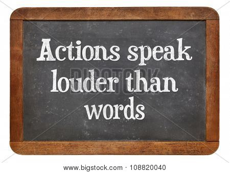 Actions speak louder than words proverb - motivational phrase on a vintage slate blackboard
