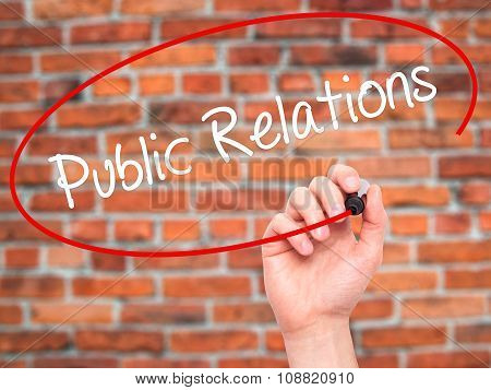 Man Hand writing Public Relations with black marker on visual screen.