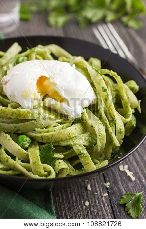 Tagliatelle Pasta With Spinach And Green Peas Pesto Poached Egg
