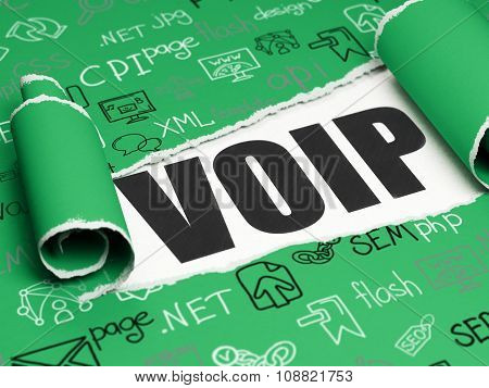Web development concept: black text VOIP under the piece of  torn paper