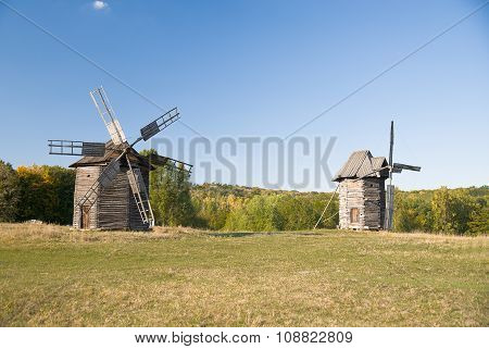 Windmills Standing In The Field Against The Blue Sky