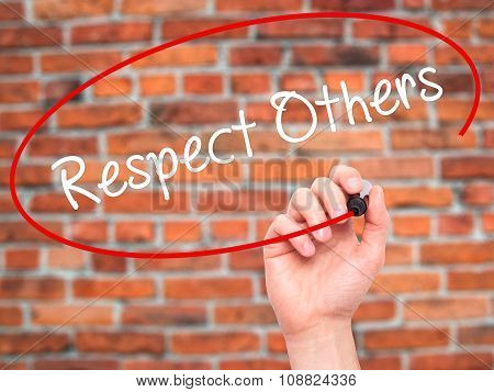 Man Hand writing Respect Others with black marker on visual screen.