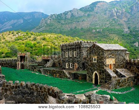 Alushta, Krimea, Ukraine - July 2, 2009: Model Of Medieval Castle In Real Mountains