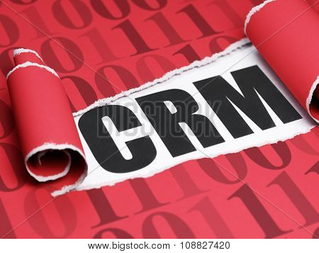 Business concept: black text CRM under the piece of  torn paper