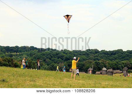 People Flying Kites In Museum Of Ukrainian Folk Architecture And Rural Life Pyrogovo In Kiev, Ukrain