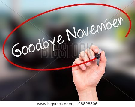 Man Hand writing Goodbye November with black marker on visual screen.