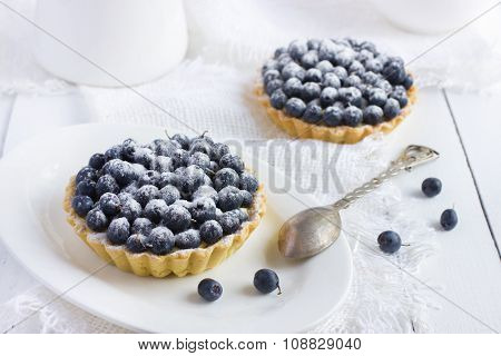 Tart With Fresh Bluebeeries And Icing Sugar