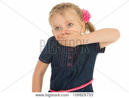 The girl closes mouth by hand