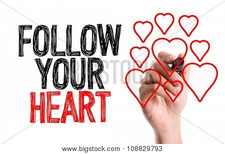 Hand with marker writing: Follow Your Heart