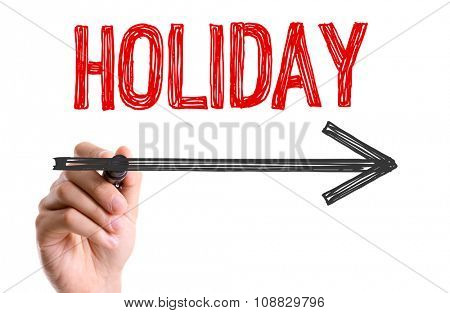 Hand with marker writing: Holiday