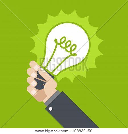 Innovation - shining lamp in hand