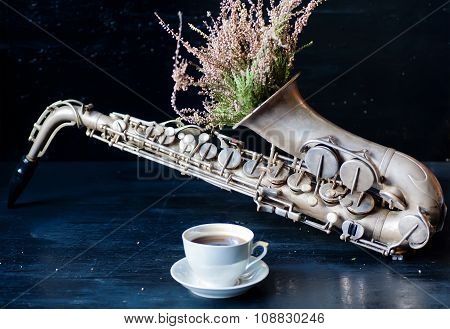 Romantic Morning With Coffee Cup And Flowers In Saxophone