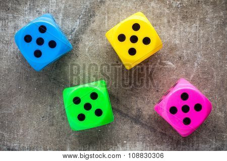 Four Color Dices On Canvas Background