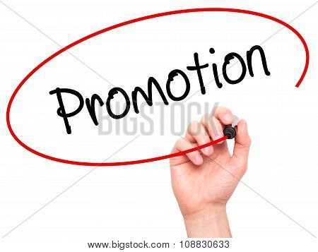 Man Hand writing Promotion with marker on visual screen.