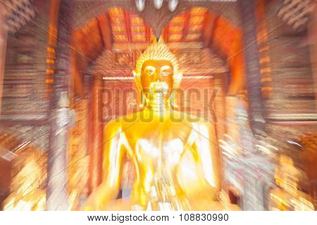 Blurred Photo Of The Beautiful Golden Buddha Statue In Thailand.