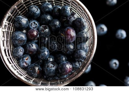Blueberries in cup strainer from above