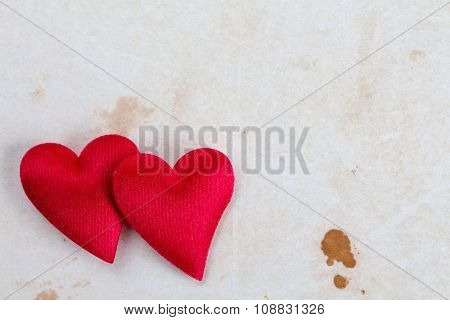 Two Hearts On Stained Paper