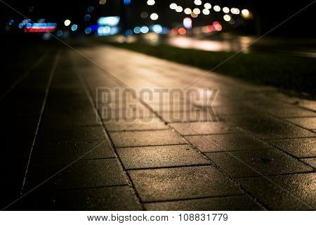 Abstract dark blurry urban background. City at night. Shallow depth of field.