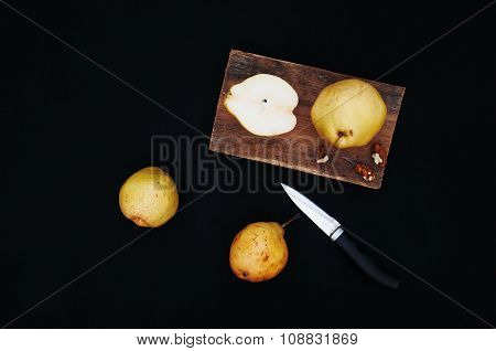 Healthy organic yellow pears on the desk. Fruit background. Ripe fresh organic pears on black backgr