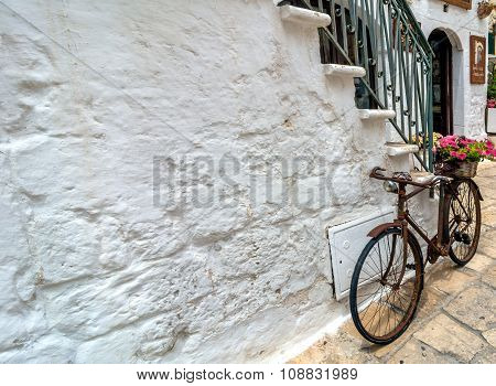 Detail Of Typical White Street With Bicycle  In Ostuni, Italy