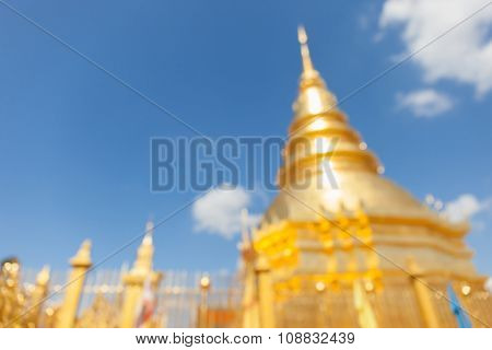 Blurred Photo Of The Famous Golden Agoda In Thailand With Blue Sky Background.