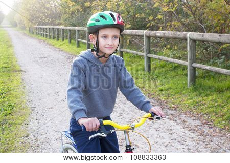 boy on bicycle in autumn park