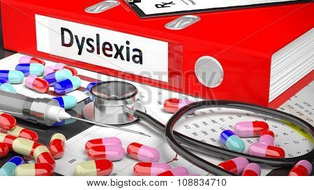 Illustration of doctor's desktop with different pills, capsules, statoscope, syringe, red folder with label 'Dyslexia'