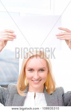 Professional businesswoman holding sheet of paper