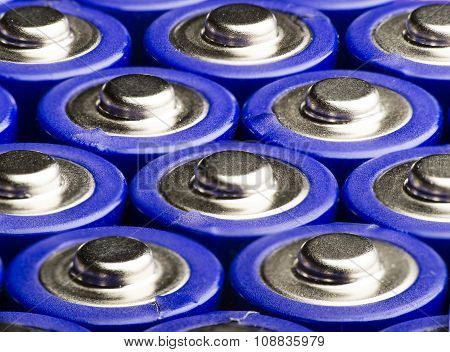 View macro of several AA blue batteries.