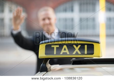 Businessman Catching Taxi