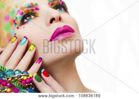 Colorful makeup and manicure .