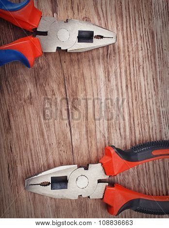 pliers on wooden