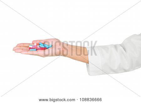 Hands Holding Pills On White