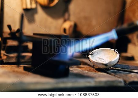 Jeweler Using Tourch To Heat Welding Tools
