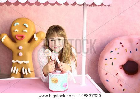 Blond Girl In Confectionery World
