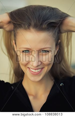 Portrait Of Smiling Pretty Girl