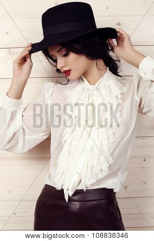Sensual Woman With Dark Hair In Elegant Clothes Posing At Studio