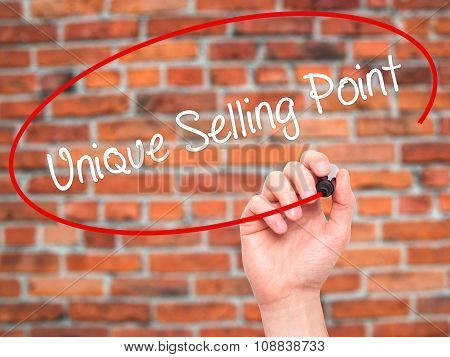 Man Hand writing Unique Selling Point with black marker on visual screen.