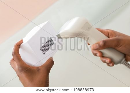Person's Hand Scanning Barcode With Barcode Scanner