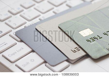 Bank card on computer keyboard