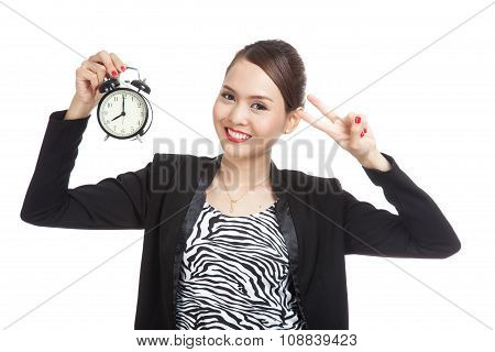 Young Asian Business Woman Show Victory Sign With A Clock
