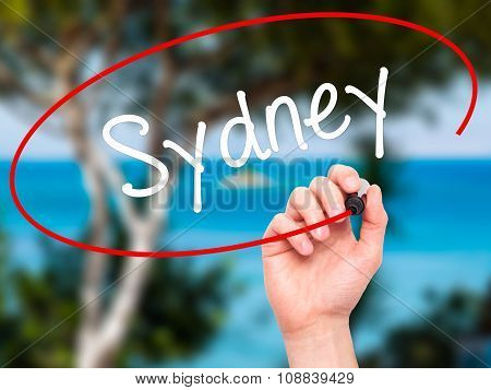 Man Hand writing Sydney with black marker on visual screen.