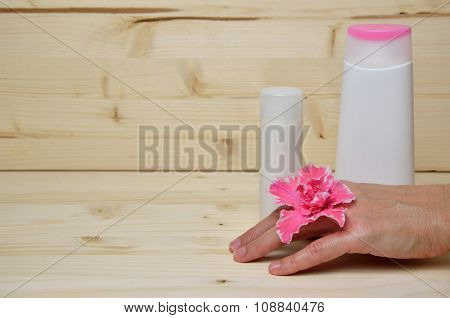 Cosmetics And Woman's Hand