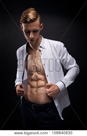 Young Athletic Man Fitness Model Torso showing six pack abs.