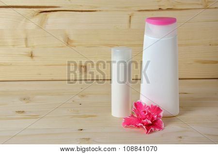 Cosmetics Bottles And Flower
