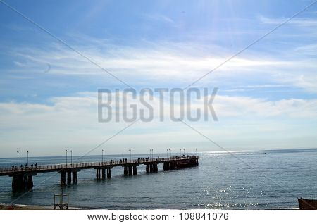 Old Wooden Pier. Calm Sea With Clear Blue Water On A Sunny Day