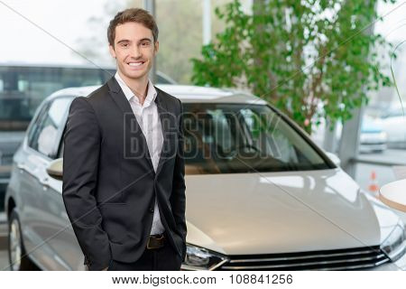 Customer is standing in front of a car.