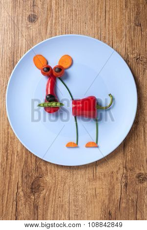 Vegetable Panther On Blue Plate On Wooden Background